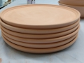 stack of bisque plates