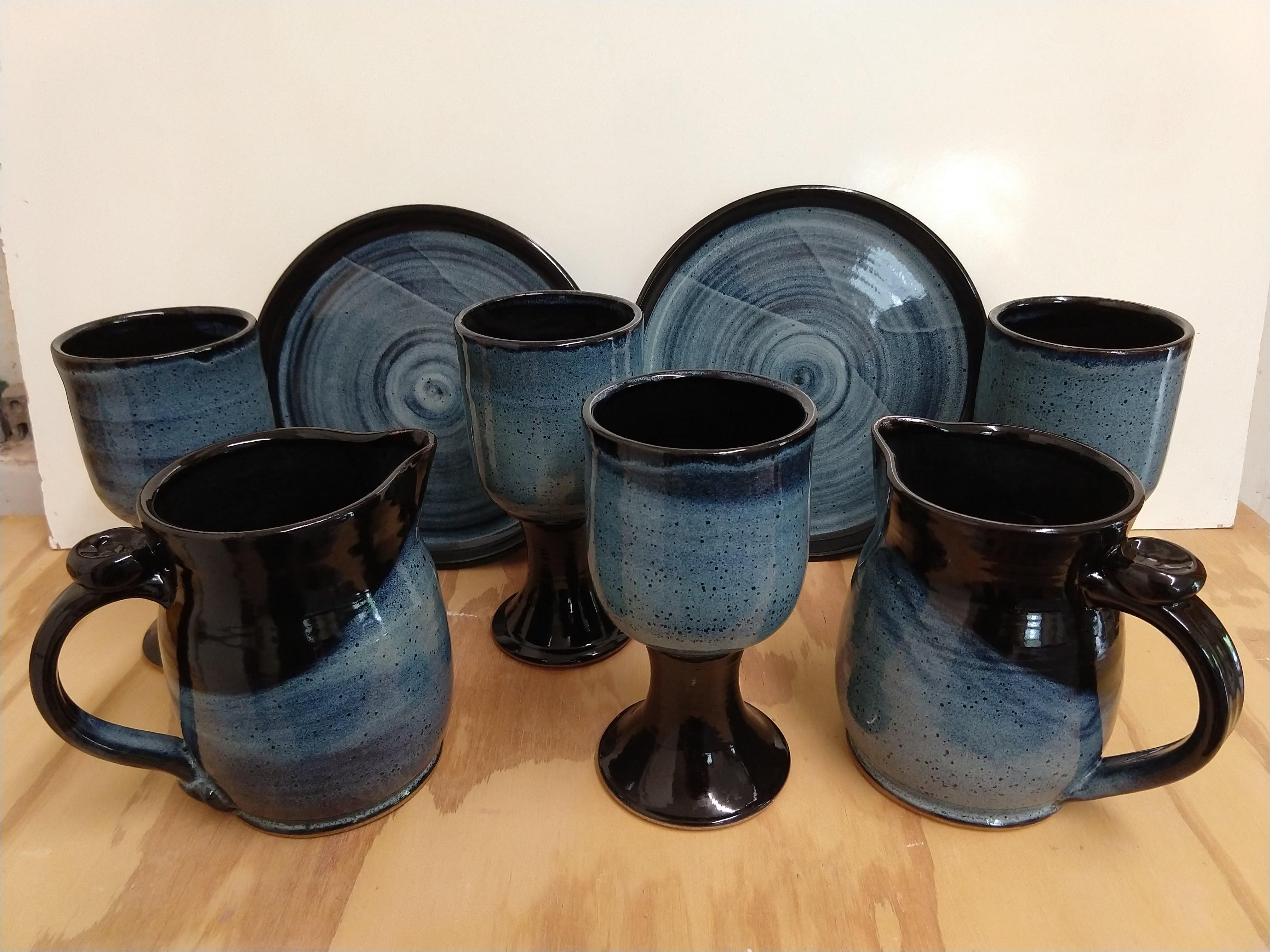 black blue chalice pitcher plate